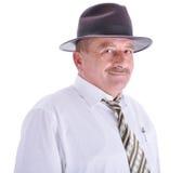 Ältere männliche Person mit einem Hut stockfotografie