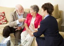 Ältere Paar-Beratung stockbilder