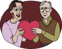Ältere Paare mit Geschenk bis zum Tag des Valentinsgrußes Stockfotografie