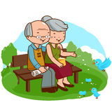 Ältere Paare am Park Stockfotos