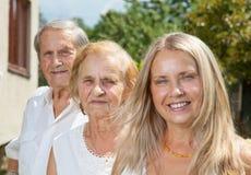 Ältere Paare und ihre Tochter Stockbild