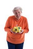 Älterer, der eine piggy Querneigung 2 anhält Lizenzfreies Stockbild