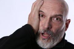 Älterer älterer Erwachsener mit einem besorgten Ausdruck lizenzfreie stockfotos