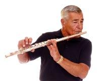 Älterer Flöte-Spieler Stockfotos