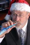 Älterer Geschäftsmann Christmas Party Stockbild