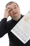 Älterer las Zeitung Lizenzfreie Stockfotografie