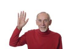 Älterer Mann, der glücklich wellenartig bewegt Lizenzfreie Stockfotografie
