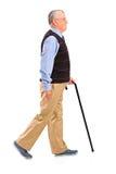 Älterer Mann, der mit Stock geht Lizenzfreies Stockbild
