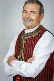 Älterer Mann in der traditionellen Kleidung Stockfoto
