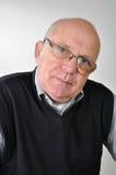 Älterer Mann mit Gläsern Stockbild