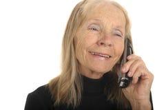 Älterer mit Telefon Stockfotografie