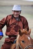 Älterer mongolischer Reiter stockfotos