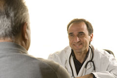 Älterer Patient an der Abfrage des Doktors Stockfotos