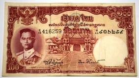 Älterer siamesischer Banknote 100 Baht Stockfoto