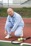 Älterer Tennisspieler Stockbild