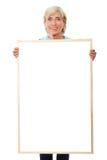 Älteres Geschäftsfrauholdingschild Stockbilder