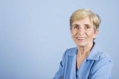Älteres Geschäftsfraulächeln Stockfotografie
