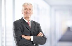 Älteres Geschäftsmannportrait Stockfotos
