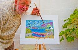 Älteres Lernen, in den Schmierölen zu malen Stockfotos