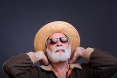 Älteres mand mit Strohhut Stockbilder