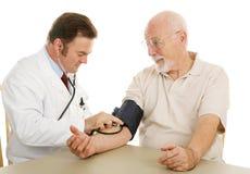 Älteres medizinisches - Blutdruck Stockfoto