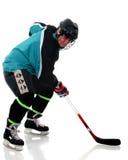 Älteres spielendes Eis-Hockey Lizenzfreie Stockfotografie