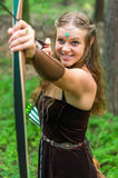 Älva för ung dam med en lång pilbåge Fotografering för Bildbyråer