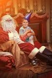 Älva och santa Fotografering för Bildbyråer