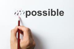 Ändern Sie von unmöglichem zum möglichen Stockbild