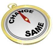 Ändra Vs samma ändrande innovation för guld- kompass Royaltyfri Foto