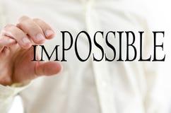 Ändrande ord som är omöjligt in i möjlighet arkivfoto