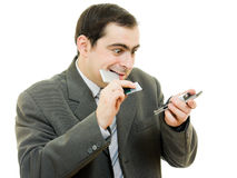 ändrande telefon för batteri affärsman Royaltyfri Foto