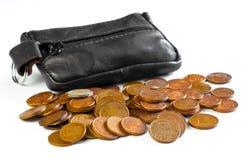 Ändringshandväska och mynt royaltyfria bilder