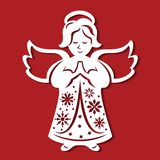Ängel för vit jul som ber på den röda bakgrunden Konturn av ängeln kan använda för kortet, laser klippa plotte Royaltyfri Fotografi
