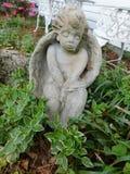 Ängel i trädgården Royaltyfria Bilder