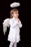 ängel little som ber Fotografering för Bildbyråer