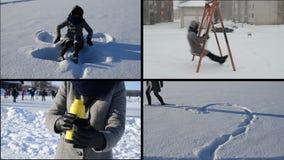 Ängel- och hjärtaform på snö Abstrakt vinterbakgrund Fyllnads- tebunkar Flickagunga arkivfilmer