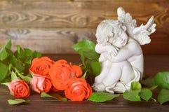Ängel och rosor Royaltyfri Bild