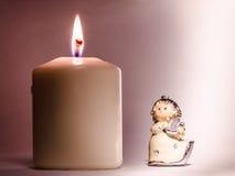 Ängel och stearinljus Arkivbild
