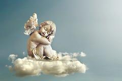 Ängel som sover på molnet Arkivbild