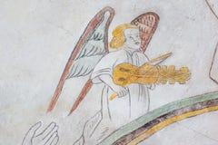 Ängel som spelar den stämde medeltida freskomålningen Royaltyfri Bild