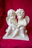 Ängel som två läser en bok Royaltyfria Foton