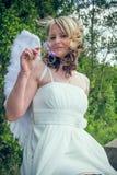 Ängelkvinna med blomman Fotografering för Bildbyråer