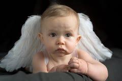 ängeln behandla som ett barn royaltyfria bilder