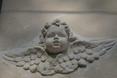 Ängelstaty, huvud och vingar Royaltyfri Foto