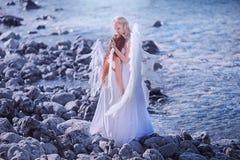 Änglar på stranden Arkivfoto