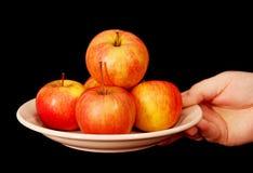 Äpfel auf einer Platte. Stockfotografie