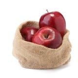 Äpfel in den Säcken auf Weiß Stockbild