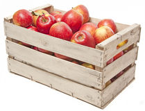 Äpfel im hölzernen Kasten Stockbild