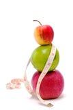 Äpfel und Maßband   Stockbilder